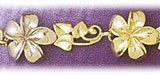 14k gold tri color plumeria flowers bracelet